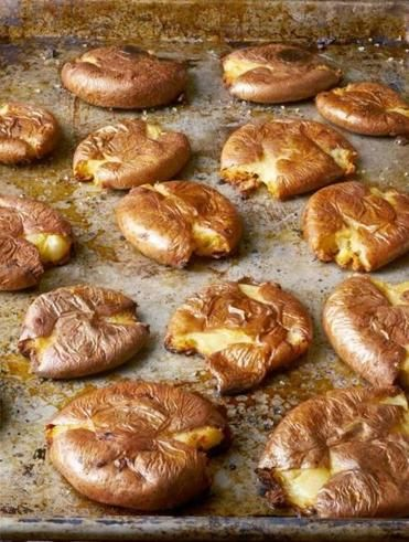 Roasted Punched Potatoes. This dish, popular in Spain and Portugal, uses salt and olive oil to flavor roasted, broken-open potatoes.