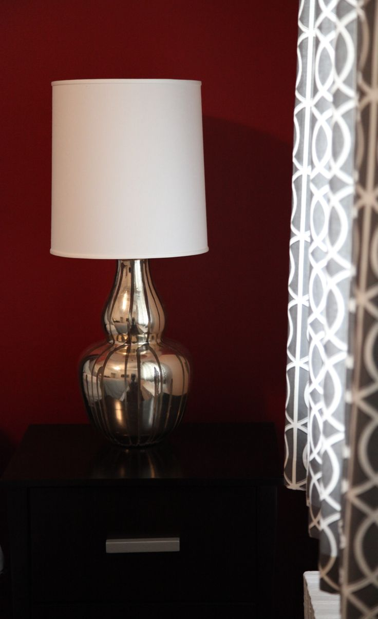 Love these Silver crackle lamps against the red will and Dwell Curtails!