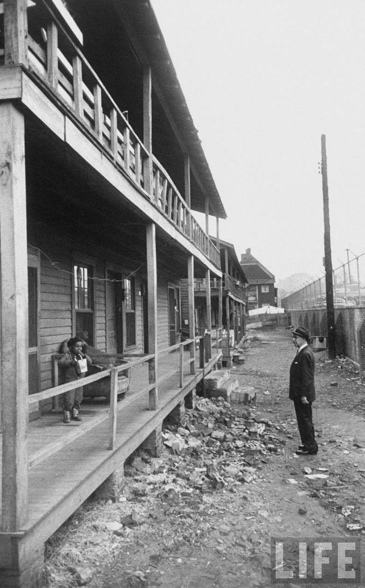 Mayor William B. Hartsfield inspecting Buttermilk Bottom, an Atlanta slum. This neighborhood stood where the Atlanta Civic Center now stands, around 395 Piedmont Avenue NE. LIFE magazine, 1959. Photographer: Grey Villet. via Atlanta Time Machine.