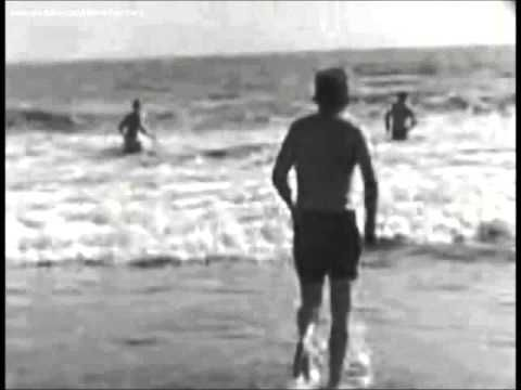 August 19, 1962 - President John F. Kennedy takes a swim at the beach in...