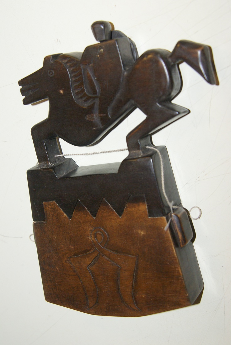 Tongal Tobacco Box from Sumba with horse and rider and carved into a zigzag shape lid. Cheetahdmr@aol.com