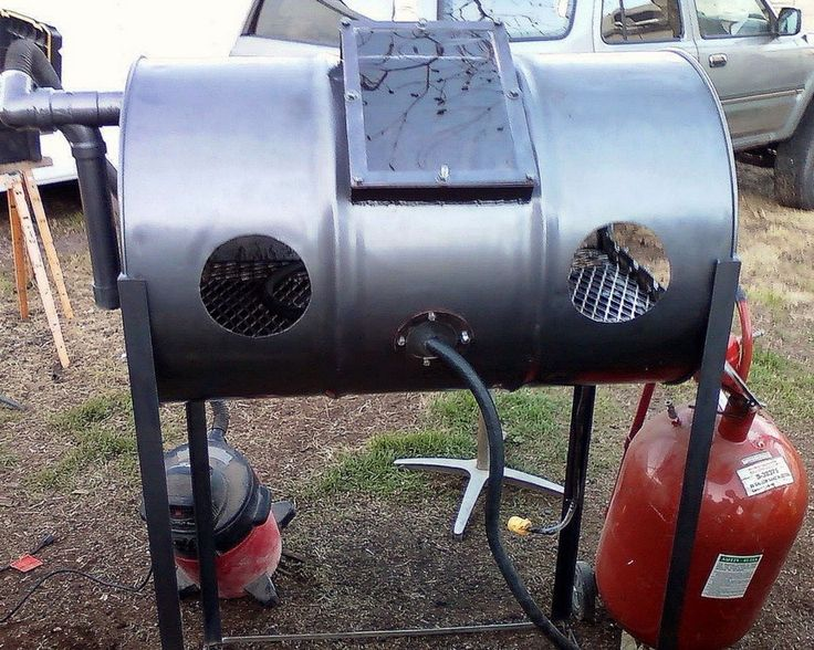 Sandblasting Cabinet by B Hastings -- Homemade sandblasting cabinet constructed from a 55-gallon drum, steel pipe, and angle iron. http://www.homemadetools.net/homemade-sandblasting-cabinet-21