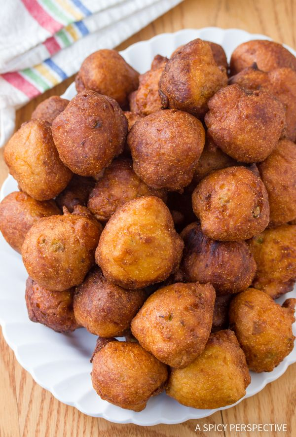 The absolute best Southern Jalapeno Hushpuppies - Recipe from the famed Okie Dokies Smokehouse in Asheville, North Carolina. The hushpuppy recipe is tender,