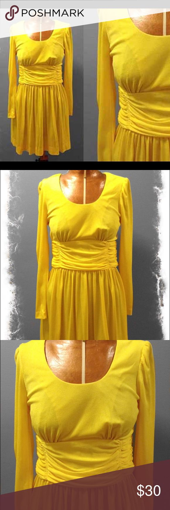 """Vintage 1970's Yellow Mini Dress The condition of this dress is excellent. There are no stains or flaws in the fabric. The zipper works perfectly as well    The overall size of this dress is very small. I would think around a size 0 even though there are no size tags indicating so.  Bust: 28""""  Waist: 22""""  Hip: free""""  Length: 16.5""""  Material: 100% Nylon  Tag: Union Made Vintage Dresses Mini"""