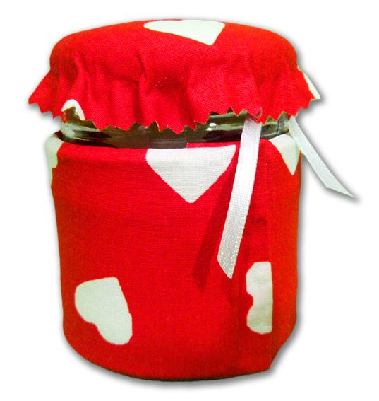 """Barattolino in vetro per profumazione armadi, cassetti o piccoli ambienti. Inserite le vostre essenze liquide senza estrarre il sacchetto assorbente, lasciando poi il tappo poggiato, ma non avvitato sul barattolino, quindi ponetelo dove volete che la vostra essenza disperda il suo aroma. Rivestimento barattolino morbido intessuto motivo """"cuoricini"""" e tappo imbottito."""