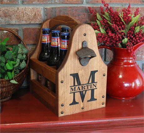 This is our premium handcrafted/handmade personalized laser engraved wooden 6 pack beer tote. It is made out of 3/4 pine and stained with a dark brown/reddish stain to give it that rich appearance. The handle is designed to keep knuckles clear of the beer caps. The tote rails are on the inside of the carrier instead of the outside like most beer totes. This gives the beer caddy/tote a much better appearance. After all, you dont want a beer/soda/home brew tote tha...