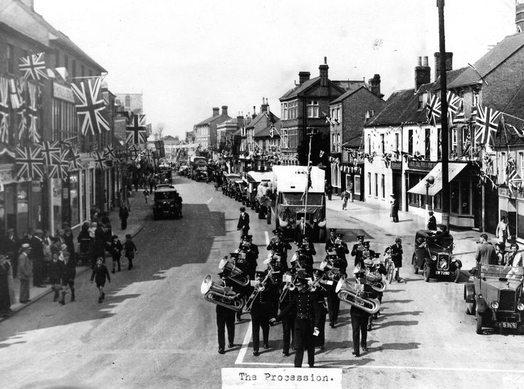 1935 Jubilee Procession in St Neots High Street led by St Neots Town Band with Mr Catmull at the front, followed by a BCH lorry and a Brittains lorry