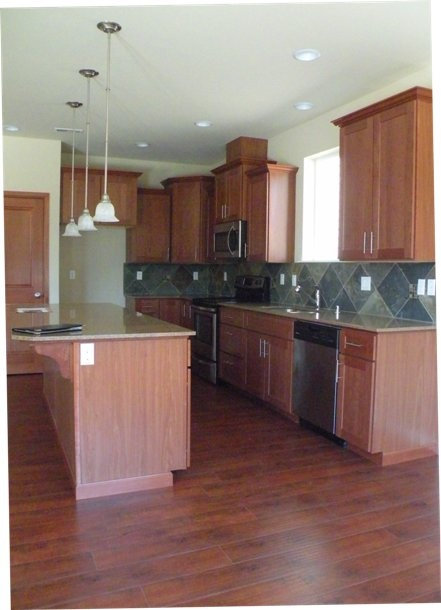 Another One Of The Beautiful Kitchens Found In The New Homes In Auburn At  Brandon Meadows   Complete With Pendant Lighting, Granite Countertops, ...