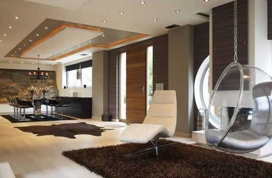 Very Stylish Futuristic House Reminding Of A Spaceship    Read more: http://www.digsdigs.com/very-stylish-futuristic-house-reminding-of-a-spaceship/#ixzz1rixqaVTM
