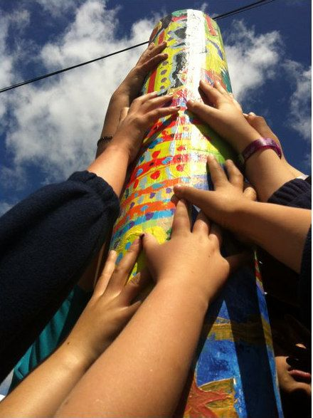 Students worked with artist in hands-on project to decorate marker posts leading the way to school.