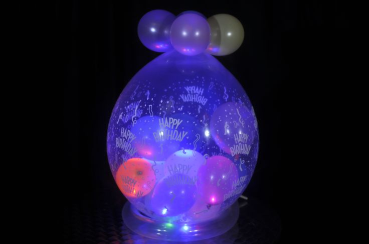 Disco Party Ball made using Party Dots® inside this balloon.  Created using a T-Rex MK2 Balloon Stuffer