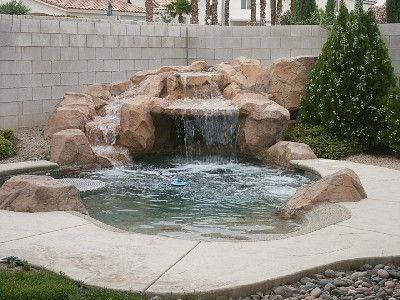 very small backyard pool. grotto. sundeck. table More