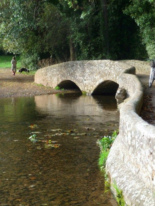 the bridge leading to a path to  Dunster Castle, Somerset - UK