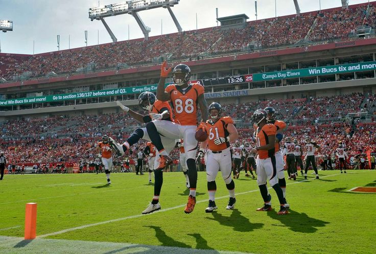 Denver Broncos wide receiver Demaryius Thomas (88) celebrates with teammates after catching an 11-yard touchdown pass against the Tampa Bay Buccaneers during the first quarter of an NFL football game Sunday, Oct. 2, 2016, in Tampa, Fla.