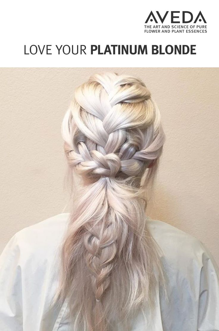 Icy cool platinum blonde pairs perfectly with a multilayered braid. Learn how to care for and elevate your platinum blonde with Aveda. With Aveda color, any shade you dream can be a reality. Find a salon near you, today. (Image courtesy Seasons Salon & Spa.) #AvedaColor