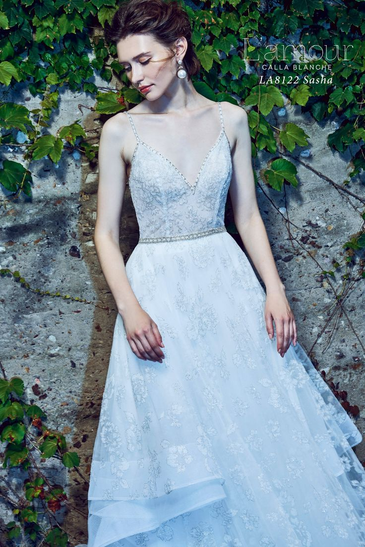 LA8122 Sasha Shimmer print ball gown with cascading layers and beaded trim on the bodice.  Available in Ivory as shown only.  #lamourbycallablanche #callablanche #callabride #shimmer #flocked #silverthread #silveraccent #cathedraltrain #train #spaghettistrap #fiance #bridetobe #bride #newlyengaged #engaged #willyoumarryme #married #romantic