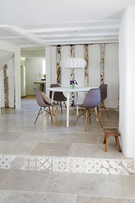 Blenheim Grey Brushed Limestone flooring combined with Palladio Grey Mix patterned tiles  riser.