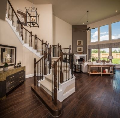 Grand entrance with deep wood floors