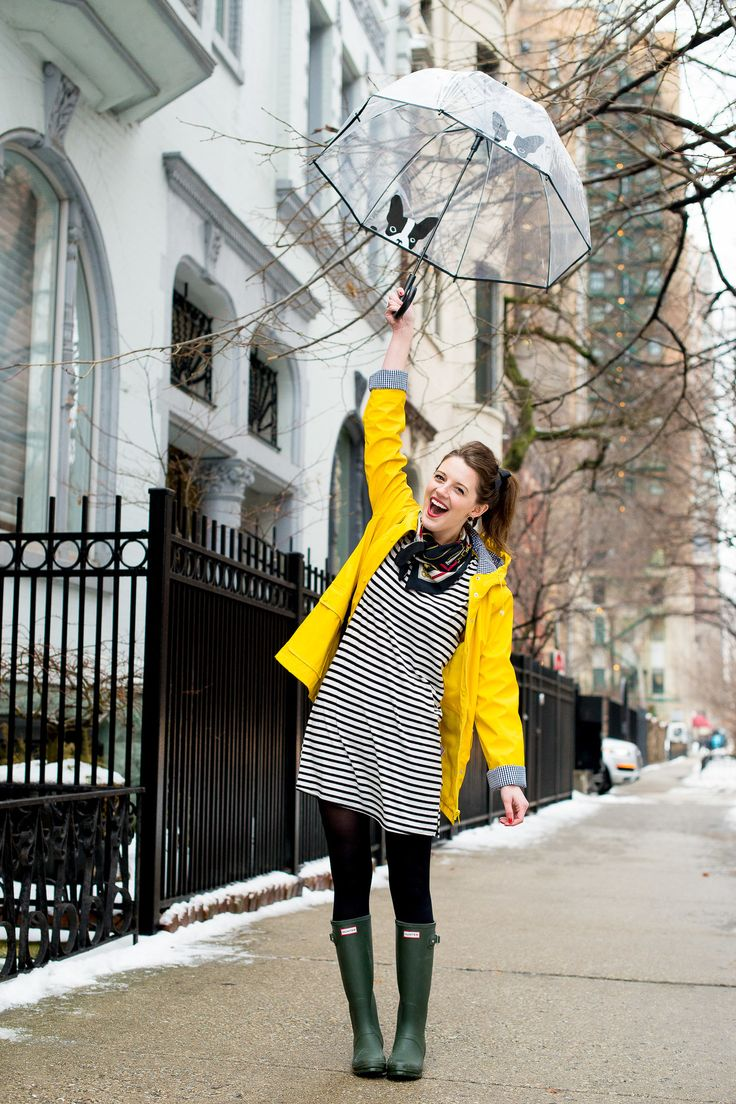 Getting nautical on a rainy day! Pairing yellow raincoat with navy stripes and green Hunter boots on The Golden Girl Blog.