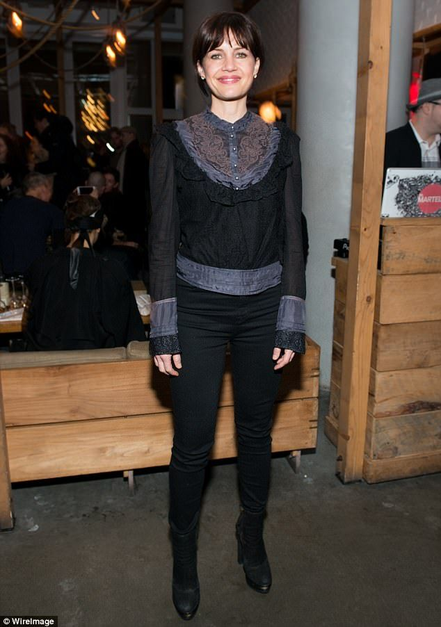 So chic: Carla Gugino arrived at the film's after-party wearing a blouse with an elaborate...