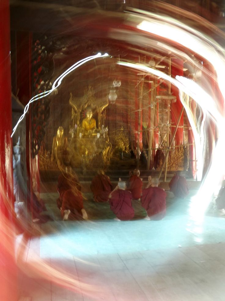 On my 26th birthday, I visited a teak temple in Mandalay. As I crept around the building, inspecting carvings and admiring the gardens, a young monk invited me inside to watch the others pray. Mandalay, Myanmar (2014)