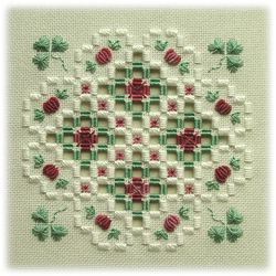 Luck of the Irish - an original Hardanger design using a variety of surface stitches to create shamrock and clover flowers