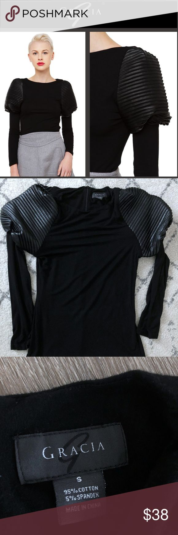 GRACIA Couture Black Widow Leather Shoulder Top GRACIA Couture Black Widow Leather Shoulder Top   The Gracia Black Widow Leather Shoulder Top features a scoop neckline, puffed & pleated pleather shoulders, long sleeves, and an invisible back zipper closure. Unlined. Rock this textured blouse with leather bottoms, pointed ankle boots, & a bold lip.   Condition: Gently used; worn once; excellent condition Color: Black Size: Women's Small Measurements:  Height (from shoulder to bottom hem)…