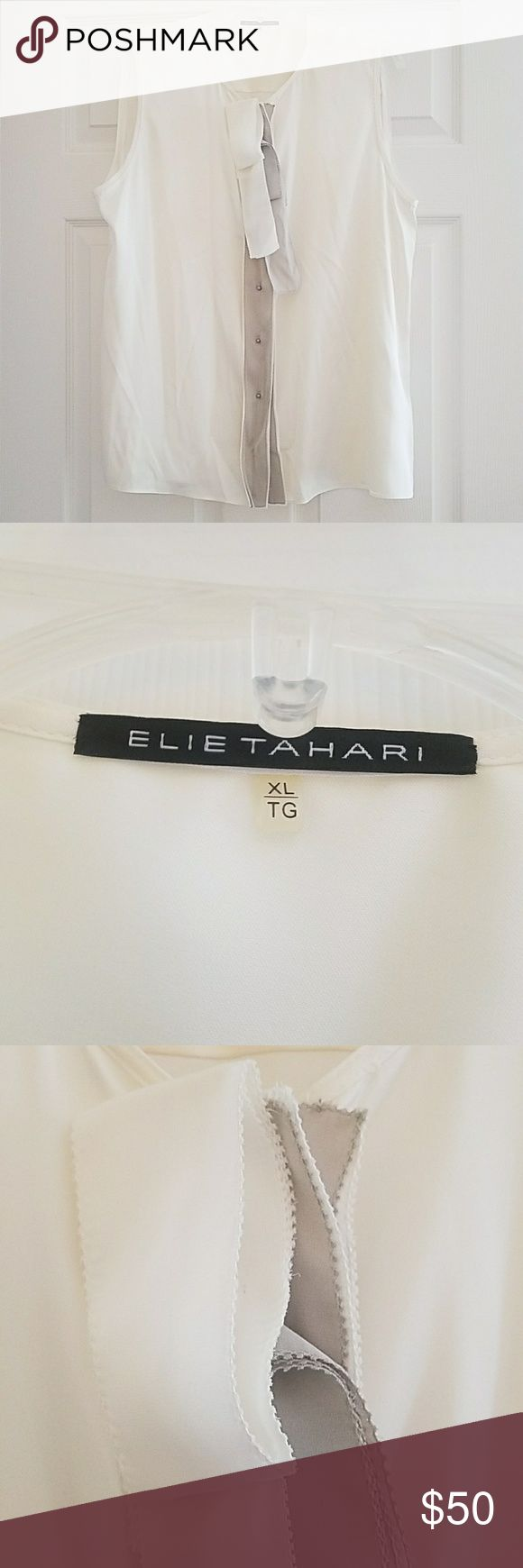 Elie Tahari Silk Cream Bow Blouse Classy Elie Tahari Silk Blouse. XL. Unique bow with light gray buttons. Very small snag on front, hardly noticeable. Good condition. Smoke free and pet free home. Great for work or a party! Elie Tahari Tops Blouses