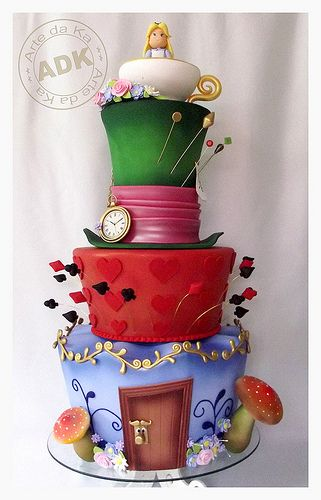 I'm not fond of the Alice figure at the top, but the rest of the cake is lovely!
