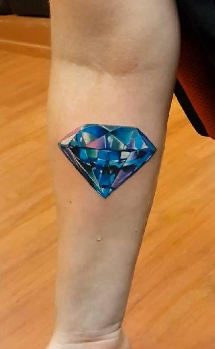 Realistic diamond tattoo on the right forearm. Tattoo artist:...