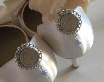 ....something blue and a sixpence for her shoe. Shoe clips inspired by the old english rhyme and handcrafted with genuine sixpences to bring a Bride good fortune and prosperity. The clips are finished of with blue 6mm Swarovski beads to traditionally represent purity, love & fidelity.  A lovely gift for any bride on her wedding day - £10.00 plus p&p