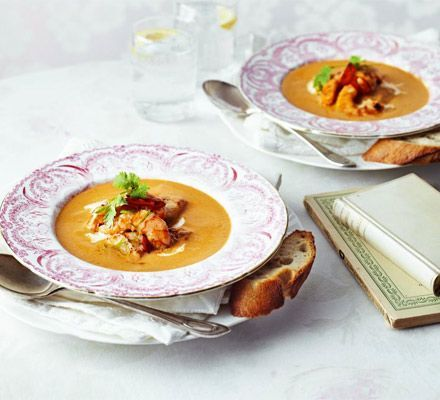 Seared garlic seafood with spicy harissa bisque. Rustle up a luxurious, romantic (and speedy!) starter for two with fresh scallops, prawns and hot chilli.