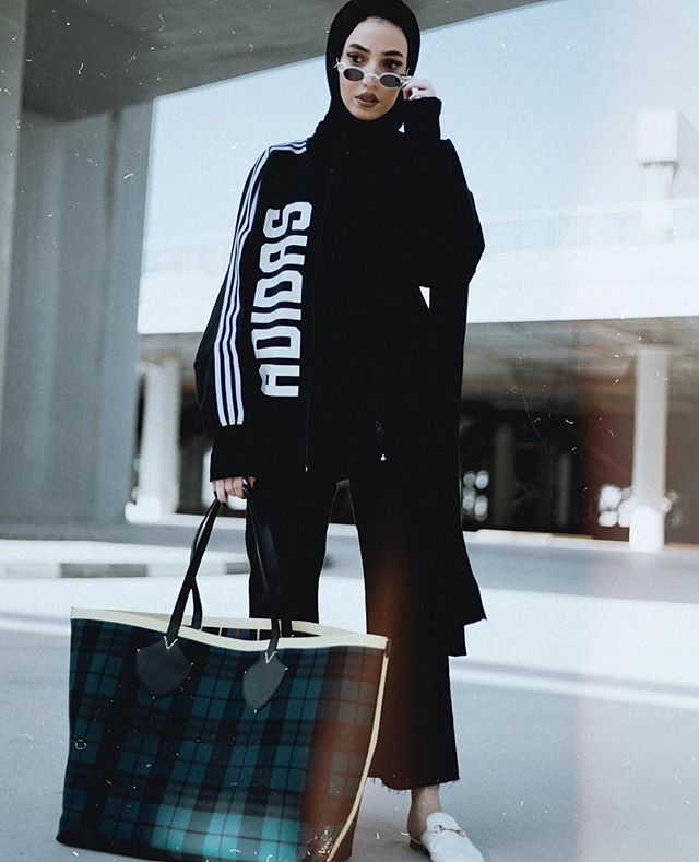 Mood. #regram @leenalghouti in @adidasoriginals jumper with @burberry tote. : @moxsantosx via ELLE UK MAGAZINE OFFICIAL INSTAGRAM - British Fashion Campaigns  Haute Couture  Advertising  Editorial Photography  Magazine Cover Designs  Supermodels  Runway Models