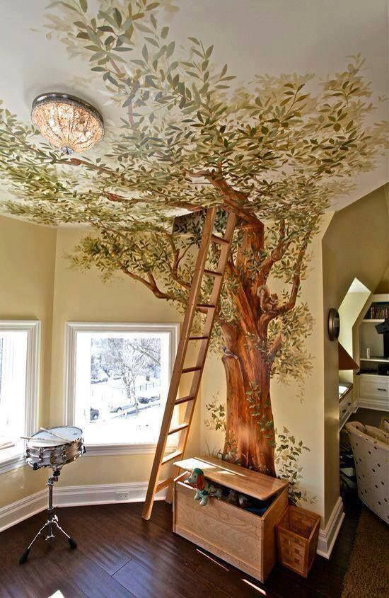 Painted tree wall mural leads to attic 'tree house'