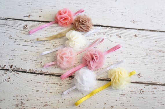 Skinny elastic tulle flowers is perfect for newborns and Made on 1/8 skinny elastic  Great for everyday wear . Measures 2 First picture shown in