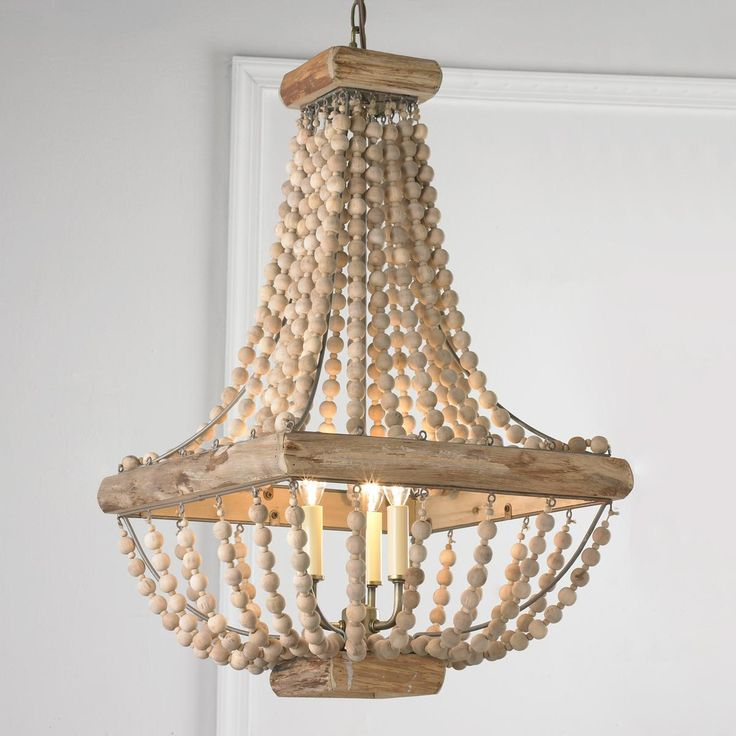 "Wood Bead Chandelier From romantic bedrooms to garden solarium spaces, this wood bead chandelier helps you lighten up!. Square distressed wood frame holds 20 natural wood bead strands.3x40 watts candle sockets. (28""Hx16""W) 4.5"" antique brass canopy. 6' antique brass chain.                                                                                                                                                                                 More"