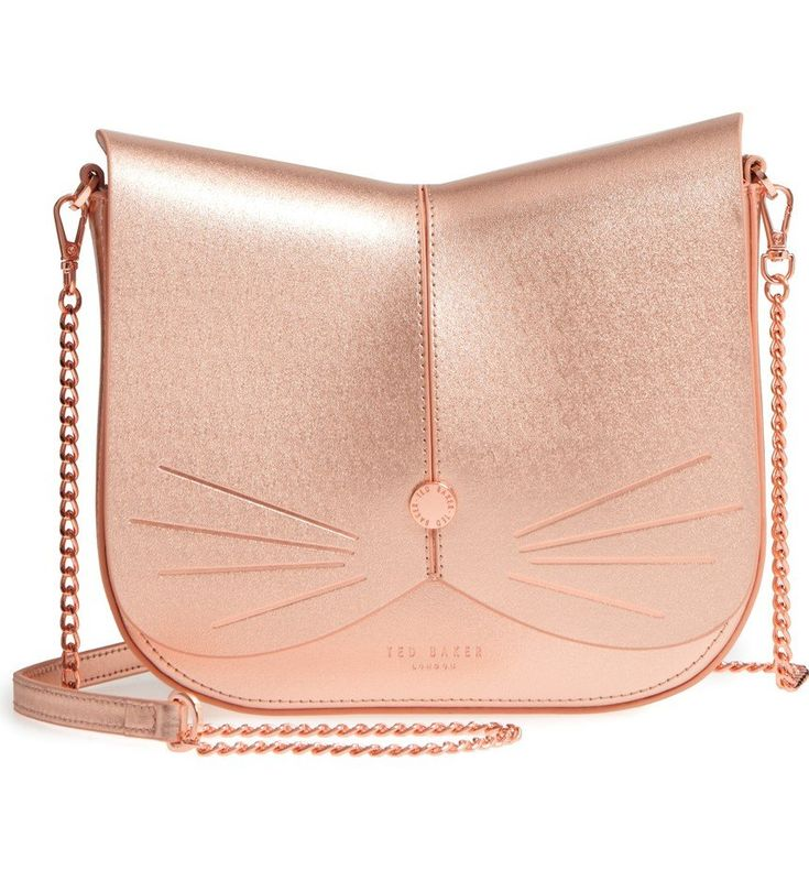 """A feline-inspired handbag complete with whiskers, a button nose and a scalloped flap will make you want to say """"Cat got your tongue?"""" more than once to onlookers."""