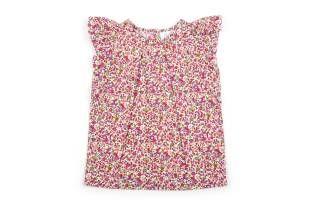Blusa para niña, confeccionada en tela estampada con florecitas en tonos morados y rojos.
