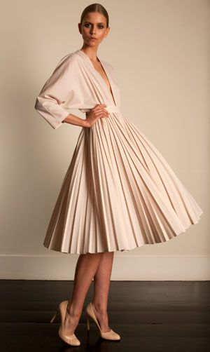 Pleated skirt - A pleat (older plait) is a type of fold formed by doubling fabric back upon itself and securing it in place. It is commonly used in clothing and upholstery to gather a wide piece of fabric to a narrower circumference.