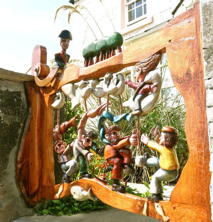 Carved wooden gate on Scottish coast