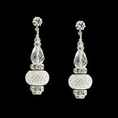 """Vintage style meets contemporary glitz. These graduated drops combine round Swarovski® crystals with dazzling charms.  2⅛"""" long Prong-set crystal stud at the post Pavé charmscovered inbox cut crystals Rhodium plated (non-tarnishing) Assembled in USA"""