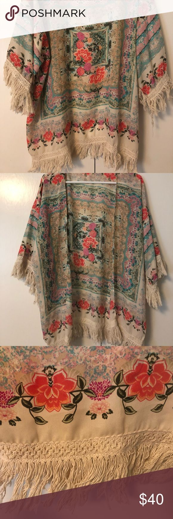 Boho chic kimono with frills This amazing boho kimono has only been worn 2 times. It has super cute full detail on the sleeves as well as around the bottom. The fun floral print and lightweight fabric makes for the perfect piece to complete a simple outfit or use as a swimsuit coverup. Tops Blouses