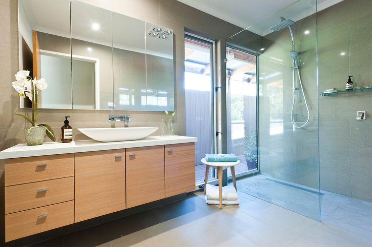Renovated en-suite bathroom. Both the en-suite and guest bathrooms were completely gutted in order to re-configure the space and layout.