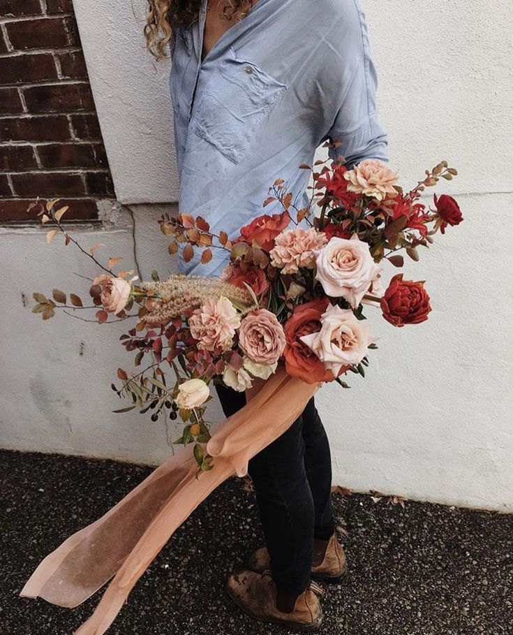 I love the way the russet roses keep the beautiful muted pink flowers from becoming too pretty...and the way the breeze catches the scarf.
