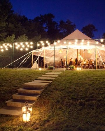 A tent strung with glowing lights for an airy reception in upstate