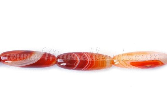 €18.00 1 Strand Long Rice Striped Agate 30x9mm Orange by Margelbeads