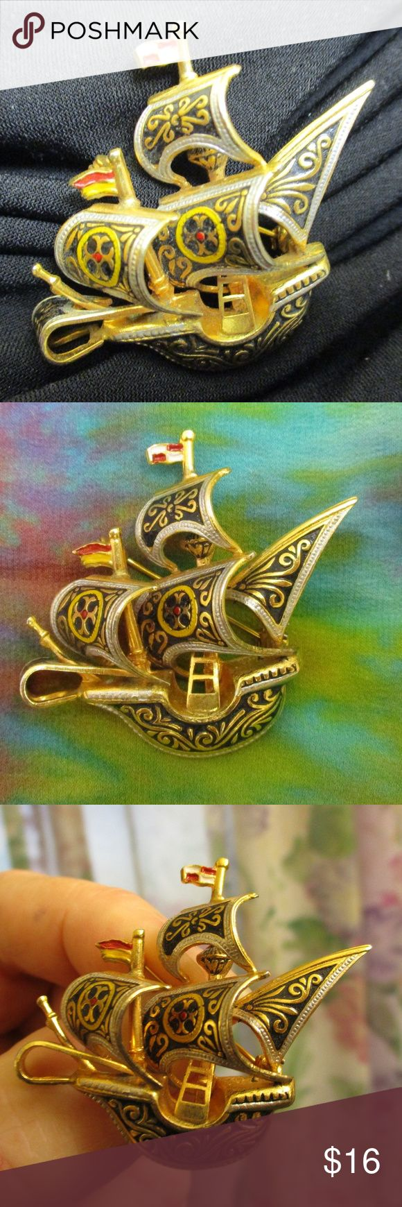 """Damascene Spanish Galleon Brooch Vintage Fascinating dimensional vintage gold plated Toledo Damascene Niello Spanish galleon brooch pin.  In pristine condition with sails and flags waving plus rigging and wooden upper deck rail visible.  Black Damascene inlay with yellow, red and white handpainted enamel on flags and sails. Damasquinado crafting at its best. Secure rollover clasp. 2"""" x 1 3/8"""" x 1/2"""" deep. EUC just polish to your satisfaction.  Own your own Spanish sailing ship!!  7.9g…"""