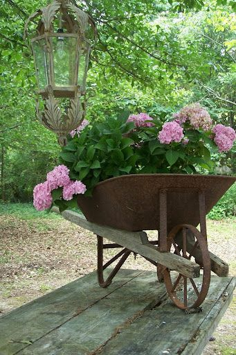 love the lantern and the Pink Hydrangea in wheel barrow