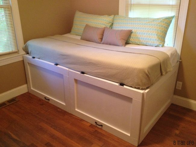 DIY daybed with extra underbed storage. Stows away so it's hidden from sight.