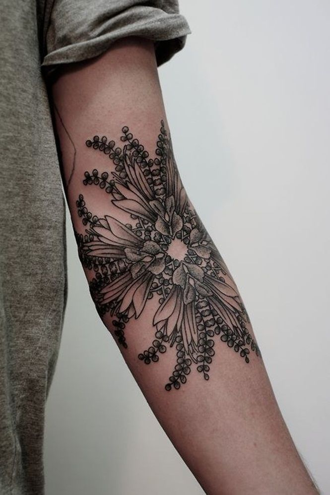 Black and gray flower arm tattoo